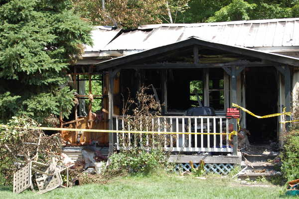 Amanda Morey, 27, of Jay was arrested on a charge of arson Friday, accused of setting fire to her mobile home a day after firefighters extinguished a blaze there.