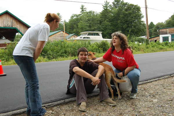 Amanda Morey, 27, of Jay (center) was arrested on a charge of arson. State fire investigators said she set fire to her mobile home on BJ's Lane on Friday, following a fire at the home Thursday. Morey sits Thursday on the edge of Route 140 with her mother, Harriet Nadeau (right) of Jay and friend Brittany Pomerleau of Jay as firefighters doused flames that heavily damaged the home. The cause of Thursday's fire was undetermined, officials said.