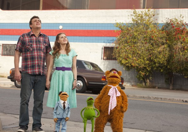 "In this image released by Disney, Jason Segel, left and Amy Adams are shown with muppet characters Walter, Kermit and Fozzie Bear in a scene from the film, ""The Muppets."""