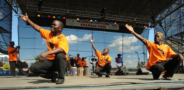 Kenge Kenge from Kenya performs on the Railroad Stage in August 2010.