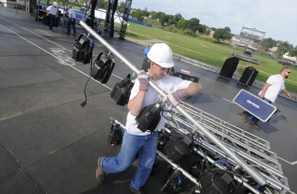 Inmates with Charleston Correctional Facility help deliver lighting to the Railraod Stage during Thursday's preparations for the American Folk Festival on the Bangor Waterfront.