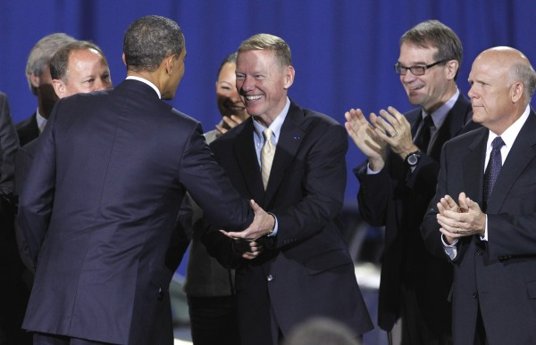President Barack Obama greets Ford President and CEO of Ford Alan Mulally (center) at the Washington Convention Center in Washington, Friday, July 29, 2011, where he announced a new fuel efficiency standards for cars and light trucks.  Looking on are Volvo Cars of North America President and CEO Doug Speck (left) and General Motors Chairman and Chief Executive Officer Dan Akerson (right).