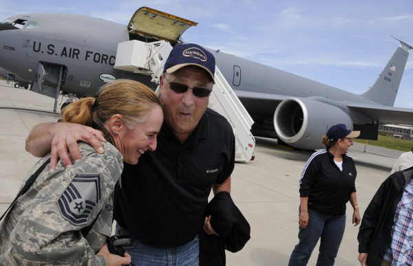 At the Maine Air National Guard base in Bangor, Gov. Paul LePage jokes with Senior Master Sgt. Kelly Hoffess after they deboarded a KC-135R Stratotanker with Maine First Lady Ann Lepage (right). The LePages and several members of the Governor's detail tagged along with the aircraft's refueling mission Tuesday morning, August 9, 2011.