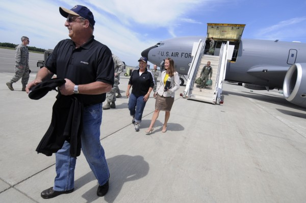 At the Maine Air National Guard base in Bangor, Gov. Paul LePage walks toward the local media after his flight aboard a KC135-R Stratotanker with  Maine First Lady Ann Lepage (seen behind him with his press secretary Adrienne Bennett).
