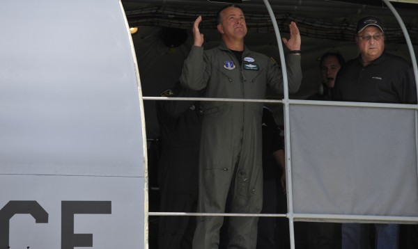 After returning to the Maine Air National Guard base in Bangor, Gov. Paul LePage (right) looks through the exit doorway of the a KC-135R Stratotanker that he and Maine First Lady Ann Lepage (not pictured) flew in with several members of the governor's detail Tuesday morning, Aug. 9. 2011.