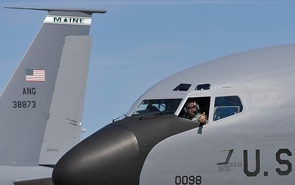 At the Maine Air National Guard base in Bangor, Major Bill Dunn signals a successful mission by giving the thumbs up from the cockpit after bringing a KC-135R Stratotanker to a stop after flying Gov. Paul LePage, Maine First Lady Ann Lepage and members of the governor's detail on a refueling mission Tuesday morning, Aug. 9, 2011.
