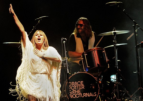 Grace Potter performs with drummer Matt Burr (in background) and other members of Grace Potter and the Nocturnals at the KahBang Festival on Bangor's waterfront Friday night, Aug. 12, 2011.