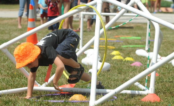 Five-year-old Micah Roberts of Frankfort crawled through the obstacle course last year during Hampden Children's Day. This year's events, with a parade at 11 a.m. and fireworks at 8:30 p.m., is set for Saturday, Aug. 20, in Hampden.