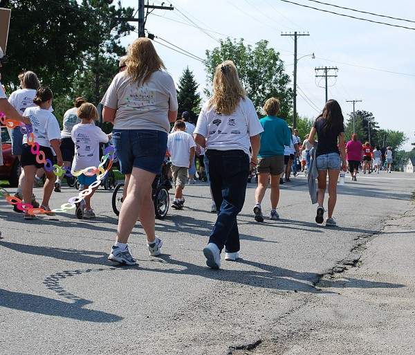 Volunteers walk Saturday, Aug. 27, for the fourth annual Bangor Walk to Defeat ALS, which drew more than 300 walkers for the 1.3- and 2.3-mile benefit walks.