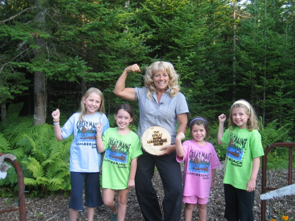 """Timber Tina"" Scheer, owner of the Great Maine Lumberjack Show, poses with girls who have come to see her perform at the show in 2008 in Trenton."