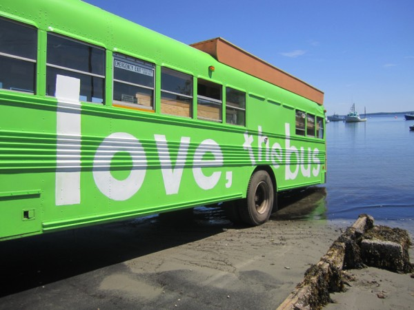 """Chartreuse,"" centerpiece of the ""Love, the Bus"" cross-country project, kisses the Atlantic Ocean in Lincolnville on launch day."