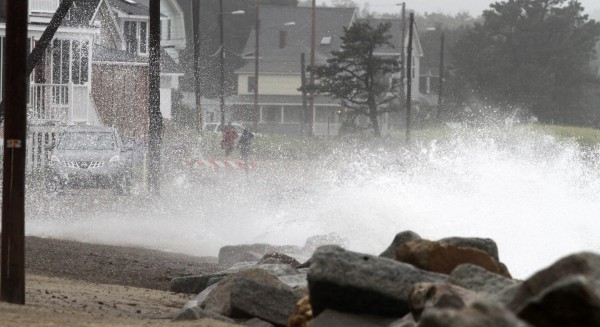 Waves crash across the road in Saco as Tropical Storm Irene makes its way into Maine on Sunday, Aug. 28, 2011. Irene caused more than 4.5 million homes and businesses along the East Coast to reportedly lose power over the weekend, and at least 11 deaths were blamed on the storm.