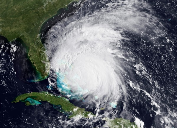 This satellite image provided by NOAA and taken at 12:15 GMT Thursday Aug. 25, 2011, shows Hurricane Irene as it approaches the northwestern Bahamas as a Category 3 storm with maximum sustained winds at 115 mph. Forecasters say Irene has slowed but is still expected to speed up again when it takes aim at the East Coast and could become a Category 4 monster by Thursday.