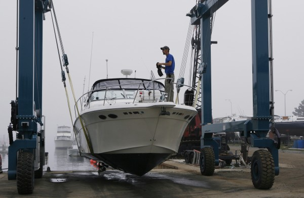 Craig Cantin coils a dock line after hauling a powerboat out of the water in preparation for Hurricane Irene on Saturday, Aug. 27, 2011, at Port Harbor Marine in South Portland, Maine.