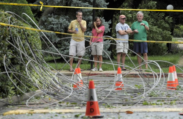 Residents of Annapolis, Md., look at downed power lines after Hurricane Irene, Sunday, Aug. 28, 2011. More than 4 million homes and businesses were without power Sunday morning as Hurricane Irene continued to roar up the East Coast and took aim at the New York City area and New England. Maryland, Delaware and Washington, D.C. had about three-quarters of a million outages combined.