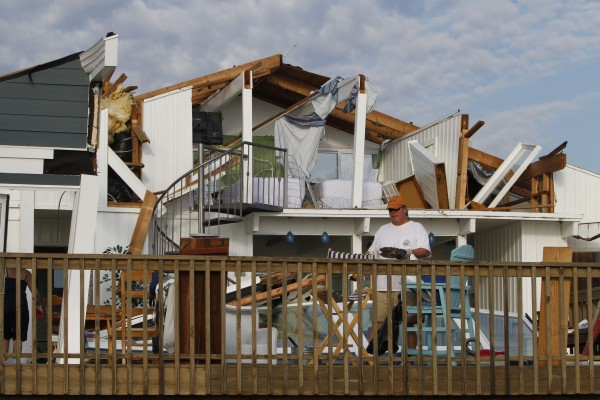 Casey Robinson clears out belongings from his severely storm-damaged beach home in the Sandbridge area of Virginia Beach, Va., after Hurricane Irene hit the region, Sunday, Aug. 28, 2011. Irene inflicted scattered damage over such a broad area that the total damage — and costs involved — were not yet known.
