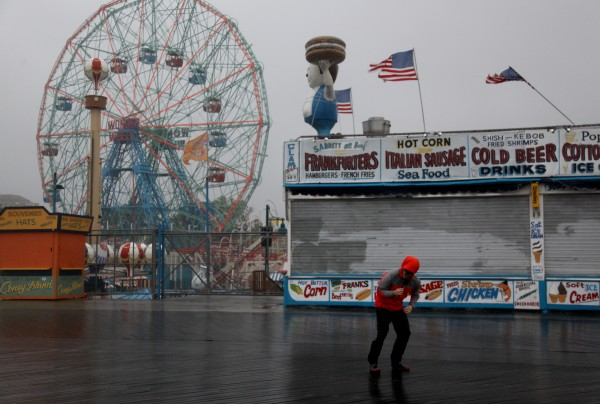NBC reporter Peter Alexander attempts to broadcast from the windswept Coney Island boardwalk in New York as Hurricane Irene became intensified Sunday, Aug. 28 2011 in Coney Island section of  New York.