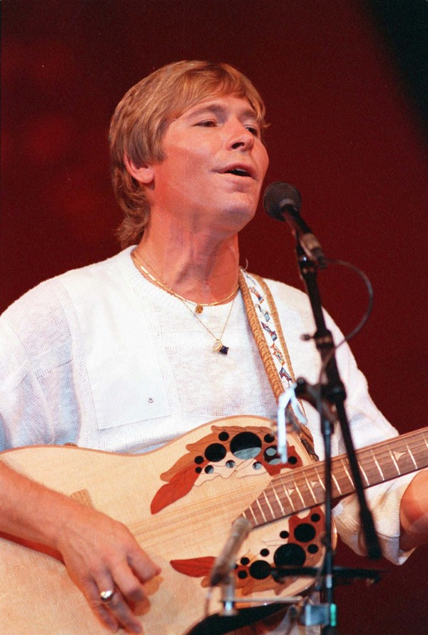 John Denver is shown performing in Moscow in this July 1, 1985, file photo. A movement to name a Colorado mountain peak after the late John Denver has hit a snag. The effort has gained momentum in recent weeks as thousands of people signed a petition to recognize the singer with a mountain near where he wrote his hit &quotRocky Mountain High.&quot Authorities say renaming the peak could be forbidden under a federal wilderness law.