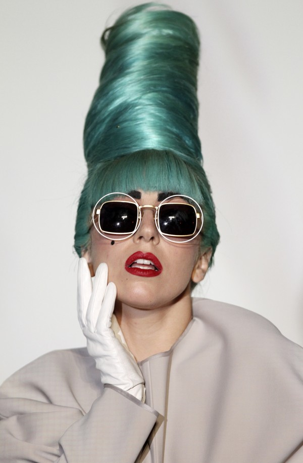 In this July 7, 2011 file photo, U.S. singer Lady Gaga gives a press conference ahead of her showcase concert at the Marina Bay Sands in Singapore.  Gaga's YouTube account was suspended Thursday, July 14, 2011. The notice read that the suspension was due to multiple or severe violations of YouTube's copyright policy.