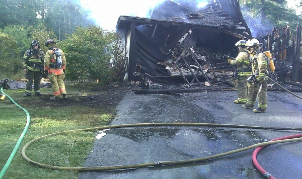 A garage and attached apartment were destroyed Monday afternoon in a fire at a home in Lamoine. According to firefighters, the homeowner had finished mowing his lawn and driven the riding mower into the garage when it backfired.