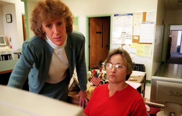 Hampden Town Manger Susan Lessard (left) consults with town Sewer Clerk Kathy Cole Tuesday, Oct. 8, 2002 at the Hampden Municipal Building.