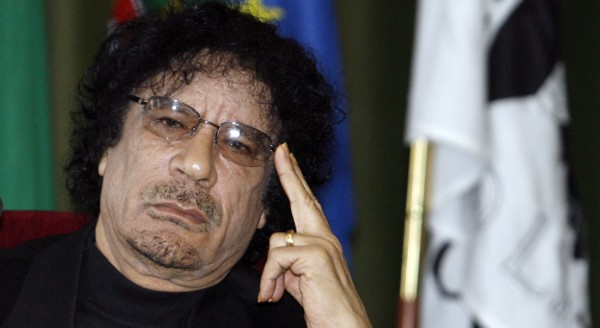 In a Dec. 7, 2007 file photo Libyan leader Moammar Gadhafi gestures while speaking during media conference at the University of Lisbon, in Lisbon.