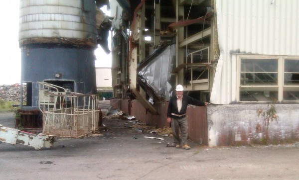 A demolition worker stands at the Loring central heat plant on Friday, August 5, 2011. The steel beams of the building are being notched to make the collapse predictable during its implosion on August 13, 2011.
