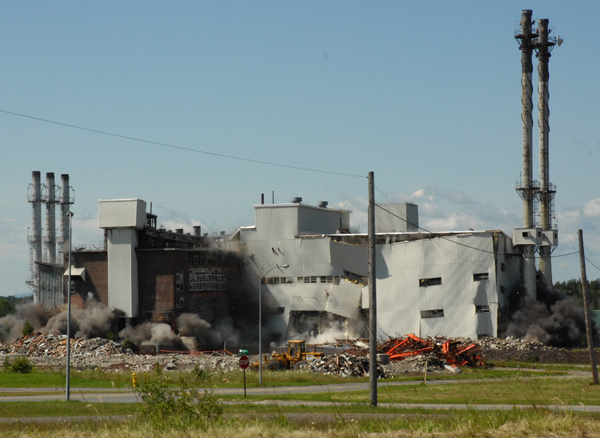 Much of the 64-year-old heat plant at Loring Air Force Base remained after a planned implosion failed to bring down the entire building Saturday.