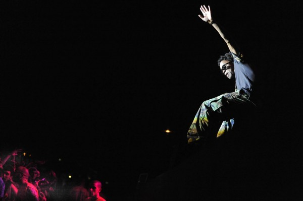 Rapper, artist, producer and music executive Lupe Fiasco teeters on the edge of the stage during his appearance at the KahBang Festival Friday night, Aug. 12, 2011.