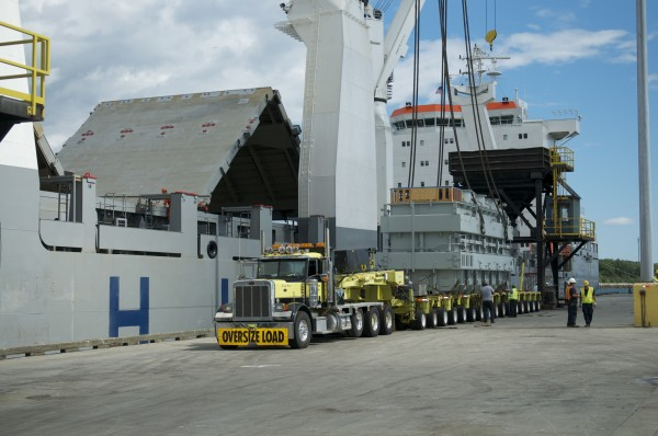 A 286-ton Central Maine Power Co. electrical transformer is loaded onto a 16-axle tractor trailer rig on July 27, 2011, at the Mack Point Marine Cargo Terminal in Searsport following a three-month ocean voyage from Taiwan.