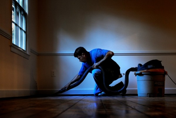 German Morales uses a vacuum to tidy up in an Alexandria, Va., house he painted. The mercurial economy has put a strain on his business. A record number of people exist on the fringes of the workforce: part-timers looking for more hours and the self-employed eager for more work.