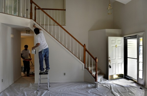German Morales, right, and Maynor Estrada work on a painting job in Centreville, Va. Morales, a Salvadoran immigrant, started his company in 2007, when the recession began. He lost his Woodbridge, Va., house to foreclosure and lost $35,000 of his elder son's college fund. The family now lives in an apartment, and Morales fights to break even on many jobs.