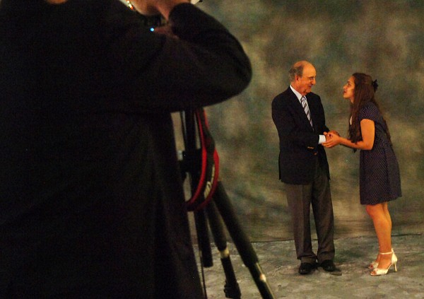 Vanessa Cousins (right) shakes hands with Senator George Mitchell after posing for a photo with him during the 2011 Mitchell Scholar Brunch held on Sunday, August 14, 2011, at the University of Maine in Orono. Cousins, a Foxcroft Academy graduate, will be attending Johnson State College in Vermont.