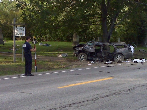 Bangor police Officer Jim Deering works with Chris Watson of the Orono Police Department to reconstruct a fatal accident that occurred near the Riverview Cemetery on Route 1A in Hampden on Monday, Aug. 22, 2011.