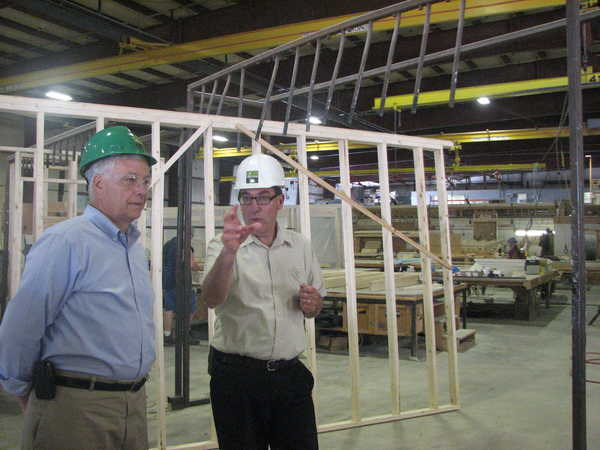Rep. Michael Michaud, left, viewed modular home construction at Keiser Industries' plant in Oxford on Monday with President David Cutler.