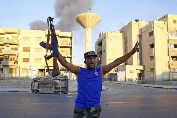 A Libyan rebel gestures in Abu Salim district in Tripoli, Libya, Thursday, Aug. 25, 2011.