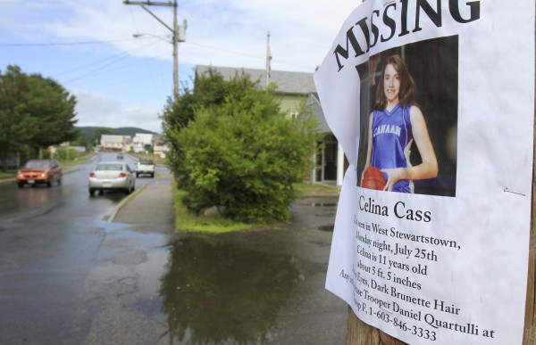 A poster still hangs on a pole on Tuesday, Aug. 2, 2011 in Stewartstown, N.H.  The lack of an arrest or answers about how 11-year-old Celina Cass died has cast a pall over her New Hampshire hometown. Searchers pulled her body from the Connecticut River near her house not far from the Canadian border on Aug. 1.