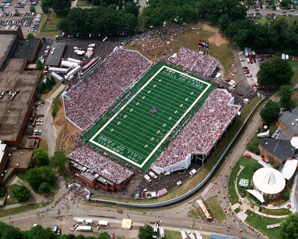 In this July 26, 1997, aerial photo, fans sits in the stands at the Pro Football Hall of Fame Stadium in Canton, Ohio, during the Hall of Fame Game. NFL players voted to OK a labor deal Monday, July 25, 2011, days after owners voted to approve a tentative agreement. The labor dispute comes to a close after claiming one exhibition: the Hall of Fame game between the Bears and Rams, scheduled for Aug. 7 in Canton. Otherwise, the entire preseason and regular-season schedules remain intact.
