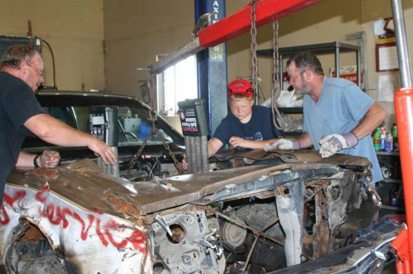Putting together a car only to have it smashed to pieces might sound a bit crazy, but for Deane Anderson (from left), Adam Williams and Bob Anderson, all of Limestone, it's pure fun to work on their entry for this year's Demolition Derby, scheduled to start at 6:30 p.m. Saturday, Aug. 6, at the Northern Maine Fairgrounds in Presque Isle.