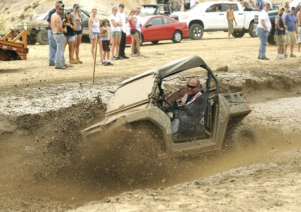 Glen Pomerleau of Poland navigates the mud pit on his all-terrain vehicle at the first annual Redneck Olympics in Hebron on Saturday.