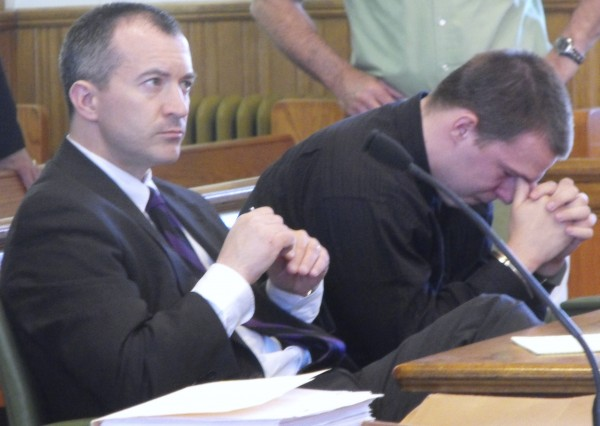 Nicklas Jones (right) cries next to his attorney, Anthony Trask, as District Court Judge Ronald Daigle rules that Jones, 18, will be tried as an adult in connection with the death of his 3-month-old daughter. Jones was 17 when he was charged with manslaughter after he allegedly threw his daughter into her crib on April 23, 2009, to stop her from crying.