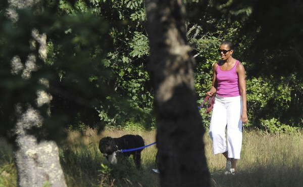 First lady Michelle Obama walks with the family dog, Bo, on the Ship Harbor hiking trail last year in Acadia National Park.