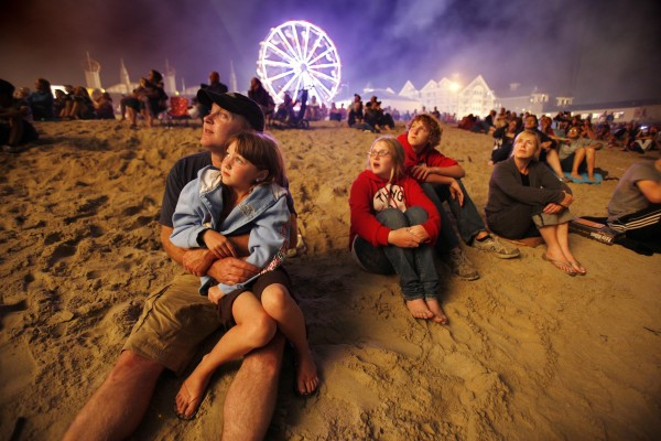 Bob Fischer, with his children, Isabelle, 8, Emma and Carson, both 14, and wife Brenda, of Barretown, Vt., watch the Thursday night fireworks at Old Orchard Beach.