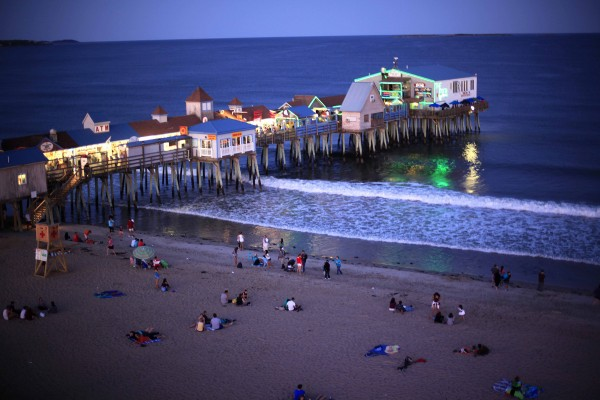 The bright lights of The Pier shine at dusk at Old Orchard Beach.