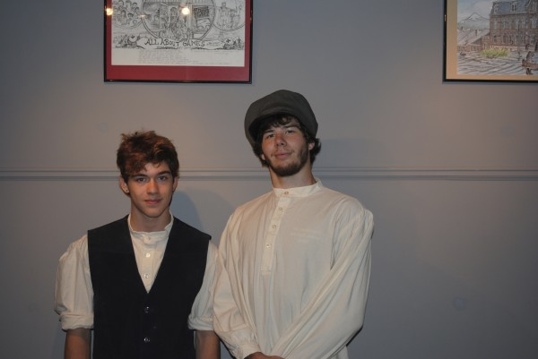 Larry Nickerson, 15, of Belfast (left) and Damion Saucier, 18, of Belfast, show off their costumes for the Pauper Auction living history event in Kings Landing Historical Settlement in New Brunswick. Both portrayed printer's assistants, or &quotdevils,&quot during the auction.