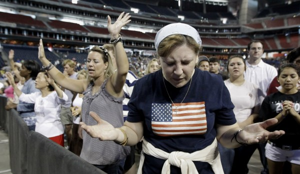 Lucy West, of Killeen, Texas, prays at The Response, a call to prayer for a nation in crisis, Saturday, Aug. 6, 2011, in Houston. Texas Gov. Rick Perry is scheduled to attend the daylong prayer rally despite criticism that the event inappropriately mixes religion and politics.