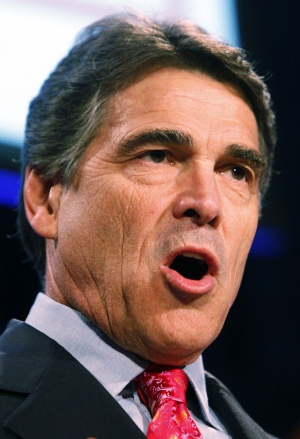 In this July 29, 2011 file photo, Texas Gov. Rick Perry addresses the Western Conservative Summit in Denver. Perry organized what seemed like a slam-dunk event for a politician in a state where religion and politics walk hand in hand: He would fill Houston's Reliant Stadium with fellow believers in a seven-hour session of Christian atonement. But this weekend's prayer rally could be a political double-edged sword now that he is eyeing a run for the White House.