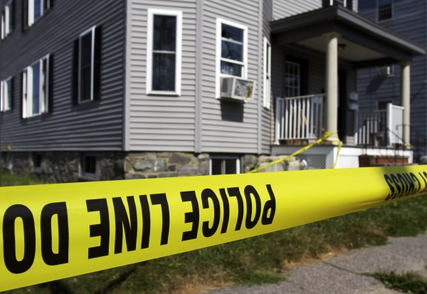 Yellow police tape surrounds the scene of an early morning incident where one man was dead in Portland, Maine, on Monday, Aug. 1, 2011.