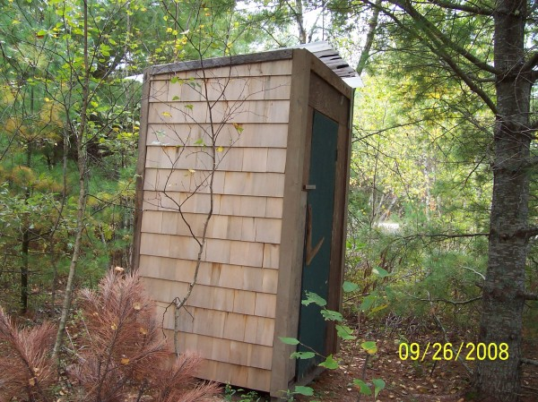 This outhouse located on Hadley Pond in Township 24 off Rt 9 in Washington County is special because three female friends built it. It was built entirely from used material that we found in the area or brought from home. Even the &quotjohn&quot was from an old destroyed camper and could actually be flushed with water kept in a bucket. The shingles appear new but were scrounged from the wood dump in my town, apparently left over from some project. The only cost was for gasoline to run the generator for the tools.