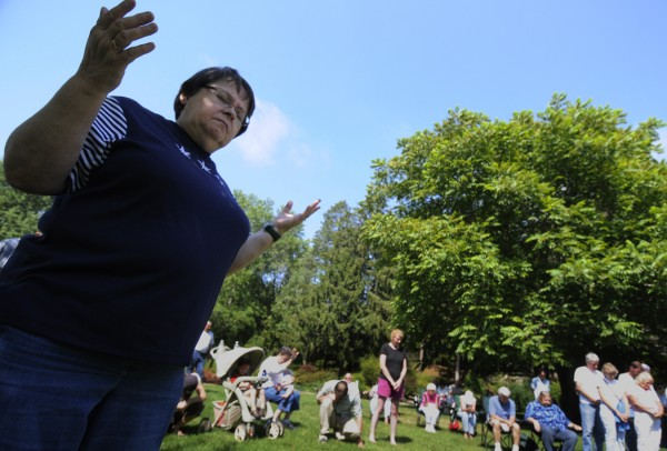 Debbie Falkenburg (left) of Carmel, a parishioner at Harvest Chapel in Levant, gathered with other area worshippers to pray for the nation at Cascade Park in Bangor on Saturday morning, Aug. 6, 2011.